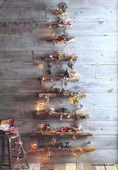 Graduated lengths of Roost Driftwood are mounted on the wall to compose this holiday tree. The top surface of each driftwood branch is milled flat and waxed to reveal