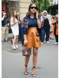 Paris Haute Couture street style Miroslava Duma wears a Louis Vuitton bag, Ray Ban sunglasses.