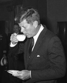 Jack Kennedy- enjoying a cup of coffee.