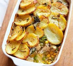 Get the kids in the kitchen to help use up leftover cooked chicken in this hearty pie topped with slices of potato