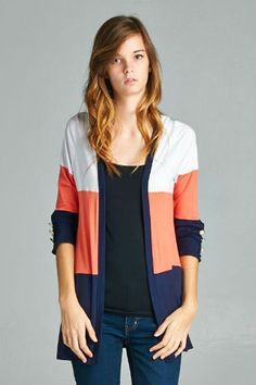 A color block cardigan featuring 3/4 sleeves with a row of button detail. Lightweight. Pair with jeans and a solid white top for a cute look. Fabric: 95% polyester. 5% spandex.