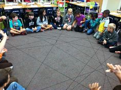 """""""experiment on how spiders sense vibrations in their webs.  I grabbed a ball of black yarn and had my students sit in a circle.  The each told a spider fact that they had learned and passed the ball of yarn around while holding on to a piece.  Soon we had a huge web.  I then had my class close their eyes and tossed rubber insects into the web.  They raised their hands to show they felt the vibration!"""""""