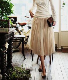 cream skirt and sweater, nice clutch