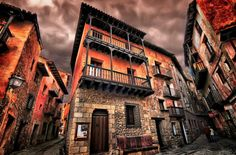 """Albarracin, Teruel, Spain.  Located on a hill Universales Mountains, is the medieval city sits on the isthmus and the peninsula formed by the river…"""