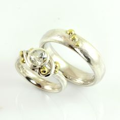 With a smile the elven king slit the glittering ring on the finger of his bride. Its elegant lines and bubbly mood matched her perfectly and her smile warmed like the midsummer sun, as she returned the favor and put his ring, which also wore some of her bubbles, on his finger.