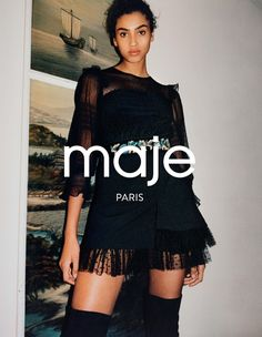 Maje's fall 2016 campaign features model Imaan Hammam wearing cropped jacket, black sweater and denim mid-length skirt