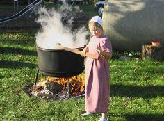 AmishGirlStirringAppleSauce.JPG (800×590)