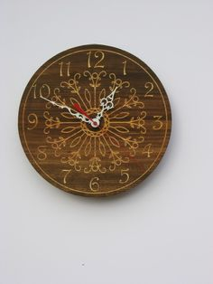 cool wood clock for either the kitchen or living room