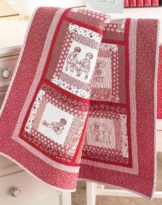Beautiful redwork quilt.