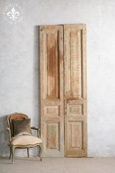 Pretty pair of vintage doors in distressed layers of sea green and milk chocolate paint. Reverse is mostly pale beige-brown, with an old stained patch of bare wood. Beautiful textural piece!  99H x 35W x 2D  These are vintage and very distressed which makes them beautiful and a great decorative piece. Please make sure to ask if they are functioning if you need them to be fully functioning doors.