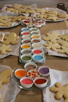 Decorating biscuits and cookies is always popular at parties, love this biscuit decorating table with everything that you need