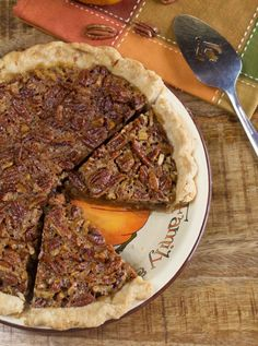 Southern Pecan Pie You'll get the perfect bite when you bite into these crunchy pecans baked on top of a sweet gooey and rich filling. Crunchiness meets rich gooey deliciousness. What a match! - My Country Table - www.mycountrytable.com