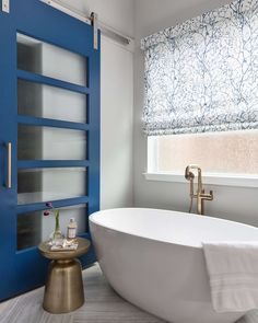 A bathroom remodel recently completed with a classic blue, custom barn door. Herringbone Floor Pattern, Glass Block Windows, Color Of The Week, Layout, Blue Design, Home Improvement Projects, Interiores Design, Decoration, Color Trends