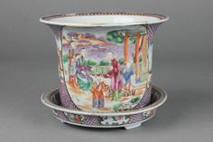 Lot 155, A good 18th Century Compagnie des arts famille rose export cylindrical jardiniere with flared neck, the fish scale ground with panels of figures and animals in landscapes with matching stand, est  £200-400