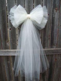 wedding pew bows tulle pew bow tulle wedding formal aisle decor by onefunday 13 00 weddingThis Tulle Pew Bow OVER 20 COLORS Church Pew Decor Tulle Pew is just one of the custom, handmade pieces you'll find in our decorations shops.Tulle Pew arc plus de 20 Church Pew Wedding Decorations, Tulle Decorations, Wedding Pews, Wedding Chairs, Bridal Shower Decorations, Diy Wedding, Wedding Flowers, Wedding Church, Formal Wedding