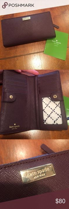 Kate spade newbury lane wine wallet VGUC! Gorgeous wine color. Comes with care card. Small amount of normal wear on inside of coin compartment. Some small scratches on name badge shown in pic. Overall very nice wallet! Used for a few months. Dog friendly smoke free home. Lots of card slots and see through ID space kate spade Bags Wallets