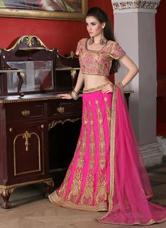 http://www.sareesaga.in/index.php?route=product/product&product_id=19987 Work	:	Embroidered Resham Work Zari Work Style	:	A - Line Lehenga Shipping Time	:	10 to 12 Days	 Occasion	:	Wedding Reception Ceremonial Fabric	:	Net	 Colour	:	Hot Pink For Inquiry Or Any Query Related To Product,  Contact :- +91 9825192886