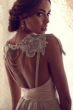 Love the beading on the back of this dress.