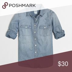 J.Crew Factory Classic Chambray Shirt Perfect Fit Excellent used condition.  Sleeves can be rolled down to full length.  Button tabs to keep sleeves rolled up.  100% cotton.  Machine wash.  Bundle other items from my closet for a 10% discount (automatically deducted when you check out)! J. Crew Tops Button Down Shirts