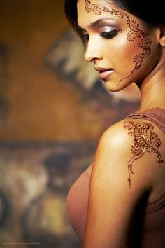 Facial henna can be so lovely, and I particularly like the way this piece follows the lines of the model's face.