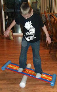Bongo balance boards from Family Fun mag.  Uses a board, colored tape, a pool noodle, and a length of PVC pipe.