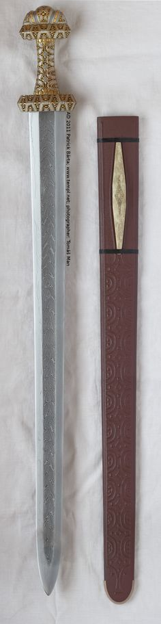 """Sword of """"D"""" type (full view) pattern-welded blade, iron hilt inlay with silver and brass. 9th Century. Blatnica, Slovakia (Hungarian National Museum, Budapest)."""