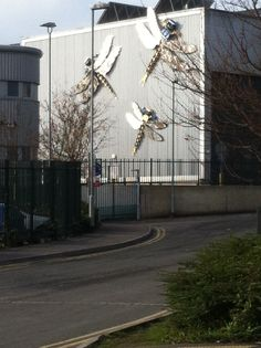 Giant insects on the side of the waste incinerator in Brighton. Ooooooooo