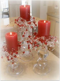Red Pillar candles on pedestal candlesticks w/red and clear hearts - Chocolate Fondue Party | CatchMyParty.com