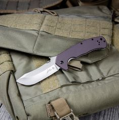 This Kershaw CQC-11k model comes equipped with a brown G-10 handle and a stonewashed blade made from 8Cr14MoV steel. This well rounded knife was originally designed as a hunting knife, but also excels as a camping, survival or general EDC knife. The unique blade shape provides an ample belly for game processing, and added slicing power. Grippy G-10 scales rest over a sturdy frame lock mechanism that offers undeniable lock up strength. Lock Up, Edc Knife, Folding Knives, Frame, Steel, Picture Frame, Butterfly Knife, Frames, Hoop