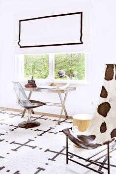Tour a Gorgeously Layered, Artistic Hamptons Home// modern desk, modern chair, cowhide sling chair, roman shade