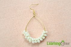 Finish making your own teardrop hoop earrings