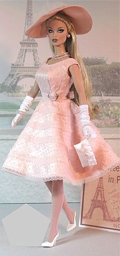 'Paris Barbie'. Barbie doll in baby pink dress, hat and gloves, with pink purse.