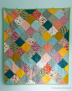 """Such vibrant colors in this """"Courthouse Steps"""" quilt by Audrie Bidwell of Blue is Bleu."""