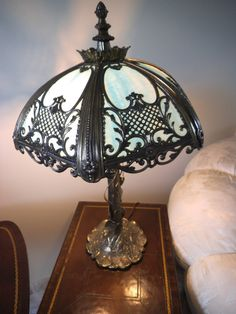 This lamp has a great detailed and very ornate waterlilies design.  Antique Style 8 Panel Green Slag Glass Table Lamp Polychrome Metal Overlay.  You can have this antique collectible lamp for only $199.00 because one of the panels is missing. Antique Style Slag Glass Lamp. All Original. Made in 1975.  Height: 29 inches Diameter: 19 inches.  Please look in my shop for more collectible items.  Email me at batog_gsm@yahoo.com if you have any questions about the item or shipping. Thank you