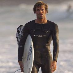 HE Surfs.  Joss Ash...nice wetsuit!