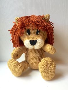 Kingsley is a crochet lion toy that wants to be loved! He is made with durable acrylic yarn with a gold body, a burnt orange mane, and a cream muzzle. His eyes and nose are sewn on with black yarn for child safety, and is stuffed with poly-fill. His big paws and snout and cute tail give him the adorable lion look. He can sit on his own, and is a total of about 12 inches in length. If you would like him in different colors, or if you would like to add a flower or a bow to making a girl lion…
