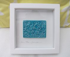 Ceramic plaque picture impressed with a wildflower design - Framed £22.50