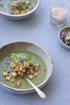 a lovely soup made with coconut milk broth, double greens (broccoli & spinach), topped with pan-fried tofu cubes, toasted almonds, and shredded scallions | 101cookbooks