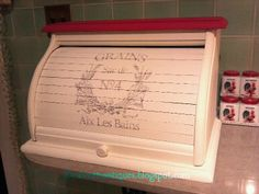 Vintage wooden roll top bread box painted in white and red chalk paint with…