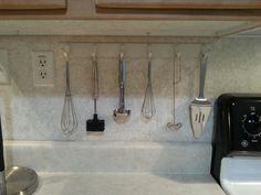 Coat rack turned kitchen utensil holder.