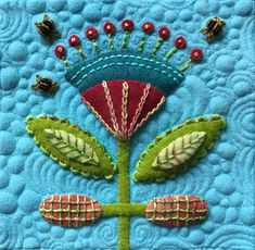 Wool applique with embroidery on quilted background