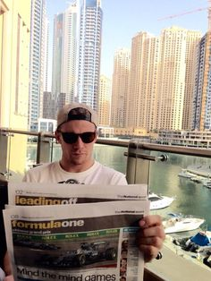 Nico Hulkenberg reads the newspaper about Mercedes wining at Chinese Grand Prix