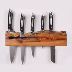 "One-Off Knife Blocks are individually handcrafted ""one-of- a-kind"" wooden wall mounted knife blocks. Each one is made using New Zealand native and exotic timbers. This knife block is made from Macrocarpa. Macrocarpa is a low- to medium-density softwood that looks and works like kauri."