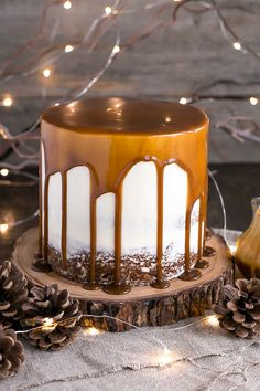 This Sticky Toffee Pudding Cake transforms the classic British dessert into a delicious layer cake! Date infused cake layers, vanilla buttercream, and a decadent toffee sauce.   livforcake.com