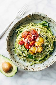 Burst Tomato and Zucchini Spaghetti tossed with a simple, creamy, vegan avocado sauce. This healthy recipe is ready in 30 minutes!