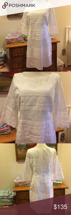 Lilly Pulitzer white 3/4 sleeve lace dress size 8 Lilly Pulitzer white 3/4 sleeve lace dress size 8.  Beautiful like new white dress.  3/4 sleeves.  100% cotton.  Gorgeous dress in like new condition. Lilly Pulitzer Dresses Midi