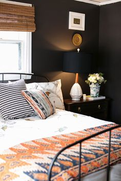 McKay dark bedroom -- interesting use of black and brown -- would probably do something different with the bed cover
