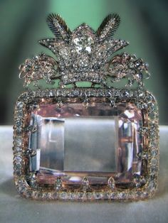 The largest known pink diamond, most celebrated diamond in the Iranian Crown Jewels and one of the oldest known to man, the 186-carat Darya-i-noor is a crudely-fashioned, pink, table or taviz-cut diamond with a name that means river of light.    The Darya-i-noor's weight of 186-carats is an estimate made by the Gemological Institute of America and the exact weight is unknown because the stone cannot be removed from its setting without risking major damage.    In 1827, Sir John Malcolm, a British