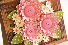 """Tutorial-for these cute flowers using the Cricut and Sweet Treats cartridge.  To make one complete flower, cut out 4 individual flowers (at 0.25"""" increments, for example one each at 1.5"""", 1.75"""", 2"""", and 2.25"""" ) Any kind of die-cut machine or punch will do, as long as you can cut the same flower in multiple sizes."""