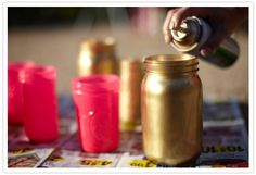 easily spray paint plastic jars (peanut butter, etc.) the theme colors for cheap centerpieces